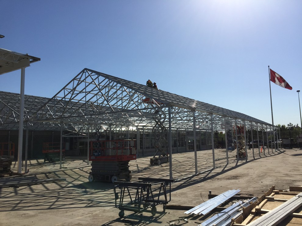 steel structures with canadian flag in background
