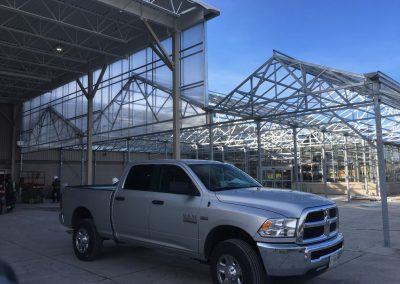 Dodge ram in front of steel structure